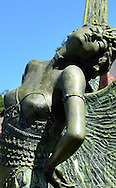 "USA: Florida: Sarasota County: City of Sarasota: Close-up of ""The Butterfly Lady"" bronze sculpture by August Moreau, one of many public art installations in Sarasota's walkable downtown."