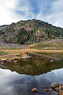 Mount Herman reflected in the water of Terminal Lake at Austin Pass. Photographed in early October at the Heather Meadows area of the Mount Baker-Snoqualmie National Forest in Washington State, USA.