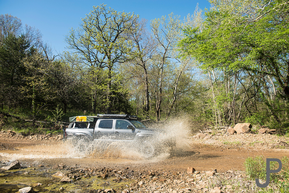 Bill and Susan Dragoo driving their Toyota Tacoma pickup truck across a low water crossing in northern Oklahoma on the Trans-America Trail.