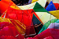 Stained glass pieces and copper wire form a colorful pastiche.