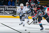 KELOWNA, CANADA - OCTOBER 26: Rodney Southam #17 of the Kelowna Rockets passes the puck away from Matthew Phillips #11 of the Victoria Royals on October 26, 2016 at Prospera Place in Kelowna, British Columbia, Canada.  (Photo by Marissa Baecker/Shoot the Breeze)  *** Local Caption ***