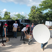 AUGUST 27, 2018--VIEQUES---PUERTO RICO--<br /> Urayoan Silva, Fe Que Transforma pastor, in his center where he stores and hands out food and basic supplies to residents who run short of them monthly. Here he receives supplies delivered by Mercy Corps.<br /> (Photo by Angel Valentin/Freelance)