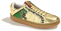 lamb gold shiny tennis shoe with  green accent
