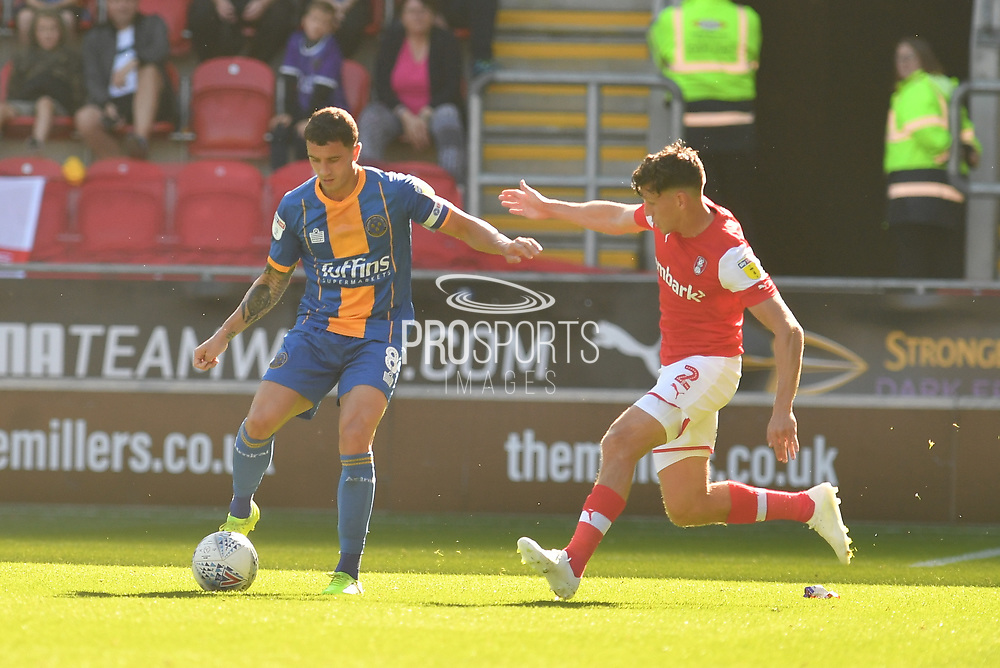 Shrewsbury Town player Oliver Norburn (8) and Rotherham United player Billy Jones (2) during the EFL Sky Bet League 1 match between Rotherham United and Shrewsbury Town at the AESSEAL New York Stadium, Rotherham, England on 21 September 2019.
