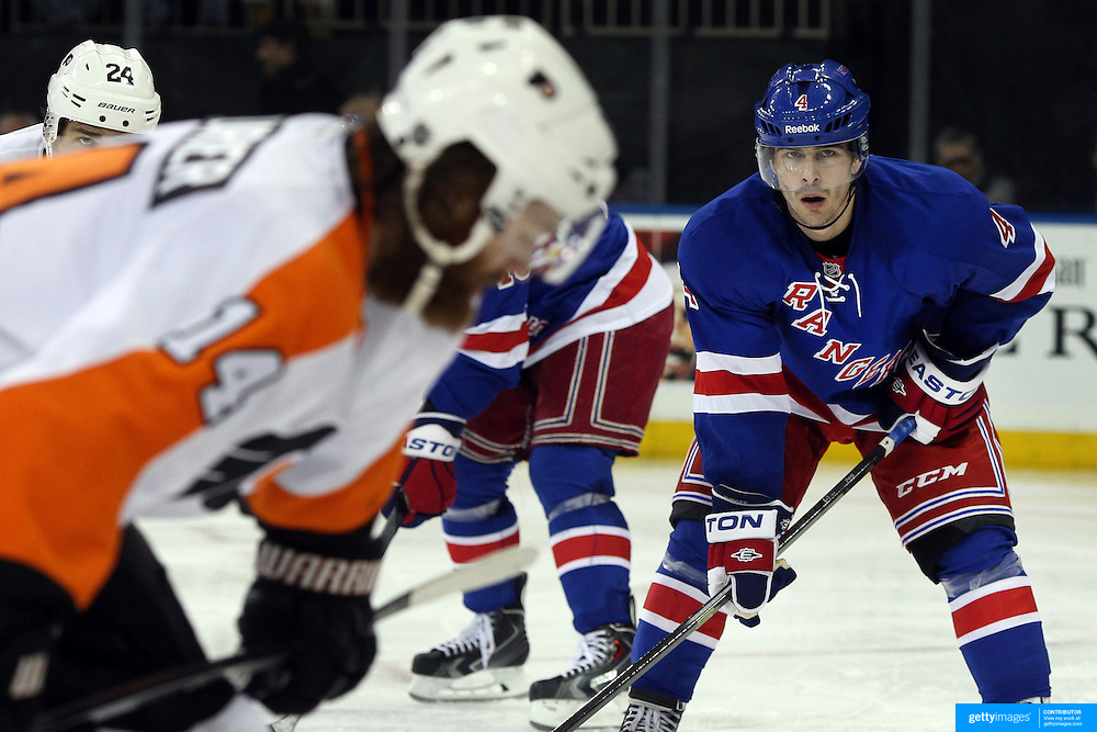 Raphael Díaz, (right), New York Rangers, in action during the New York Rangers Vs Philadelphia Flyers, NHL regular season game at Madison Square Garden, New York, USA. 26th March 2014. Photo Tim Clayton