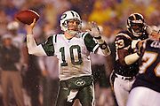 SAN DIEGO, CA - JANUARY 8:  Quarterback Chad Pennington #10 of the New York Jets unloads a pass while completing 23 of 33 passes for 279 yards and 2 touchdowns against the San Diego Chargers at Qualcomm Stadium on January 8, 2005 in San Diego, California. The Jets defeated the Chargers 20-17 in overtime in the AFC Wild Card Game. ©Paul Anthony Spinelli  *** Local Caption *** Chad Pennington