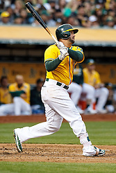 OAKLAND, CA - JUNE 17:  Yonder Alonso #17 of the Oakland Athletics hits an RBI sacrifice fly against the Los Angeles Angels of Anaheim during the second inning at the Oakland Coliseum on June 17, 2016 in Oakland, California. (Photo by Jason O. Watson/Getty Images) *** Local Caption *** Yonder Alonso