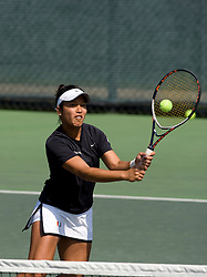 Miami's Caren Seenauth hits a volley in the #2 doubles match.  The #12 ranked Miami Hurricanes defeated the #50 ranked Virginia Cavaliers in women's tennis 6-1 at the University of Virginia's Snyder Tennis Center in Charlottesville, VA on March 22, 2008.