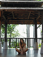Thailand young woman in bikini sitting on floor