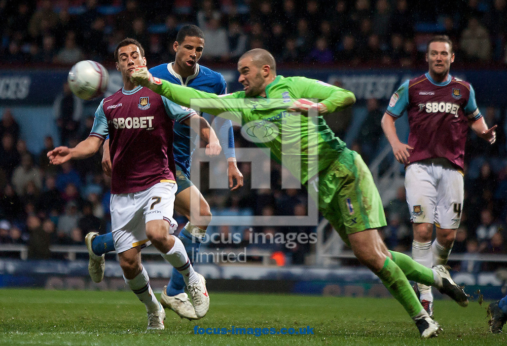 Picture by Daniel Chesterton/Focus Images Ltd. 07966 018899.09/04/12.Boaz Myhill of Birmingham City clears from Sam Baldock of West Ham during the Npower Championship match at the Boleyn Ground stadium, London.