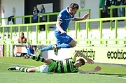 Forest Green Rovers forward Christian Doidge (9) is pushed over by North Ferriby United defender Ben Middleton (15) 0-0 during the Vanarama National League match between Forest Green Rovers and North Ferriby United at the New Lawn, Forest Green, United Kingdom on 1 April 2017. Photo by Alan Franklin.
