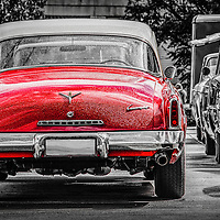 Classic Studebaker car in red from the 1960's in rain