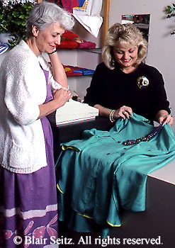 Active Aging Senior Citizens, Retired, Activities, Shopping. Clothing Store, Boutique, Couple Apparel Buying Woman Shops Alone