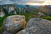 A mountain monestery sits atop limestone mountains near Meteora, Greece