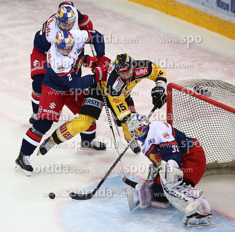 13.10.2015, Albert Schultz Eishalle, Wien, AUT, EBEL, UPC Vienna Capitals vs EC Red Bull Salzburg, 11. Runde, im Bild Brian Fahey (EC Red Bull Salzburg), Danny Bois (UPC Vienna Capitals) und Luka Gracnar (EC Red Bull Salzburg) // during the Erste Bank Icehockey League 11th Round match between UPC Vienna Capitals and EC Red Bull Salzburg at the Albert Schultz Ice Arena, Vienna, Austria on 2015/10/13. EXPA Pictures © 2015, PhotoCredit: EXPA/ Thomas Haumer