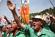 Supporters of Lega Nord (Northern League party) wear green-shirt at a meeting in Pontida, Sunday, June 14, 2009.