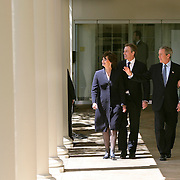 Pres. Bush and British Prime Minister Tony Blair hold a joint press availability in the Rose Garden of the White House Friday, April 16, 2004.  Bush and Blair discussed the ongoing situation in Iraq.  Also attending are Blair's wife, Cherie, and First Lady Laura Bush...Photo by Khue Bui
