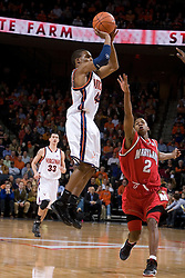 Virginia's Sean Singletary (44) shoots a three pointer over Maryland's D.J. Strawberry.  The Cavaliers defeated the #22 ranked Terrapins 103-91 at the John Paul Jones Arena in Charlottesville, VA on January 16, 2007.