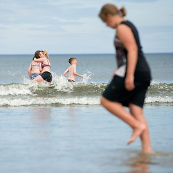 © Licensed to London News Pictures. 24/07/2012..Saltburn Beach, Cleveland, England..As temperatures rise visitors to the beach in the seaside town of Saltburn by the Sea in Cleveland enjoy their day. ..Photo credit : Ian Forsyth/LNP