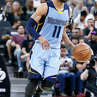 04 April 2017: Memphis Grizzlies guard Mike Conley (11) brings the ball up court during the San Antonio Spurs 95-89 OT victory over the Memphis Grizzlies, at the AT&T Center, San Antonio, Texas, USA.