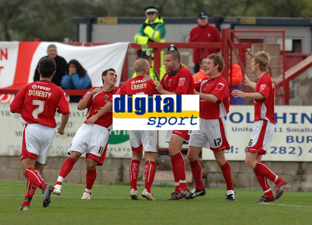 Photo: Paul Greenwood.<br />Accrington Stanley v Swindon Town. Coca Cola League 2. 07/10/2006.<br />Ian Craney (8) runs to celebrate Accrington's goal with his team mates.