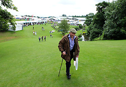 © Licensed to London News Pictures.14/07/15<br /> Harrogate, UK. <br /> <br /> A man walks up a grassy hill as he visits on the opening day of the Great Yorkshire Show.  <br /> <br /> England's premier agricultural show opened it's gates today for the start of three days of showcasing the best in British farming and the countryside.<br /> <br /> The event, which attracts over 130,000 visitors each year displays the cream of the country's livestock and offers numerous displays and events giving the chance for visitors to see many different countryside activities.<br /> <br /> Photo credit : Ian Forsyth/LNP