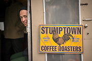 Bo Taunell of Stumptown Coffee Roasters helps celebrate the opening of Green Zebra Grocery