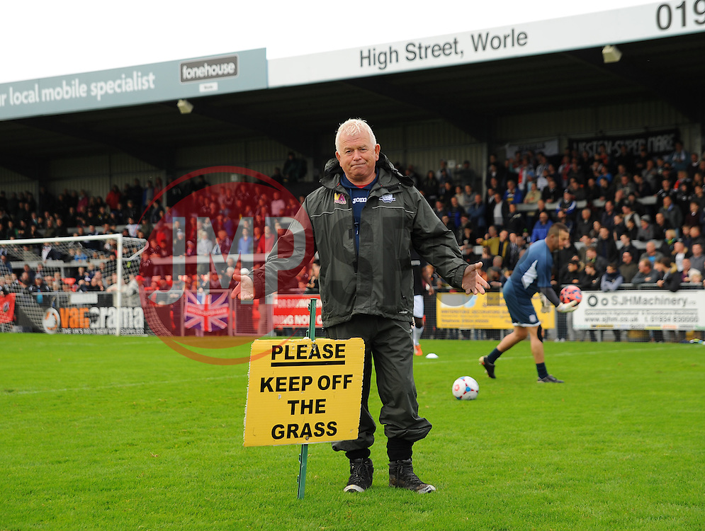 Weston Super Mare groundsman Bob Flaskett, is pictured with a sign after the match is postponed.   - Photo mandatory by-line: Nizaam Jones - Mobile: 07583 387221 - 08/11/2014 - SPORT - Football - Weston-super-Mare - Woodspring Stadium - WSM v Doncaster - Sport - Round One