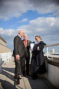 Photo by Matt Roth<br /> Assignment ID: 30148071A<br /> <br /> Michael Widomski, a spokesman for the National Weather Service, left, and David Hagedorn, a chef and food writer, spend time with Supreme Court Justice Ruth Bader Ginsburg before she officiates their wedding on the rooftop area of Fiola Restaurant in Washington, DC, Sunday, September 22, 2013.