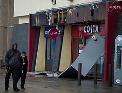 © Licensed to London News Pictures. 15/09/2015. Brighton, UK. The front of Costa coffee on Brighton seafront blown of in strong winds this morning (TUES) as high winds and heavy rain batter Brighton seafront on  the south coast of England.  Photo credit: Ben Cawthra/LNP