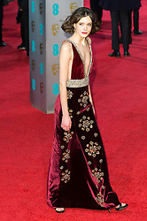 © Licensed to London News Pictures. 14/02/2016. London, UK. STACEY MARTIN arrives on the red carpet at the EE British Academy Film Awards 2016 Photo credit: Ray Tang/LNP
