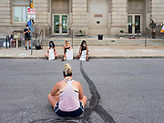 08 JUNE 2020 - DES MOINES, IOWA: An woman sits in the middle of Robert D. Ray Drive and listens to the Des Moines City Council debate a racial profiling ordinance on a Zoom call. About 150 people staged a sit-in in front of the Des Moines City Hall Monday afternoon and listened to the City Council debate an ordinance about racial profiling. The sit-in was organized by Des Moines' Selma, a civil rights organization based in Des Moines. Des Moines' African-American community has sponsored and coordinated a series of events to draw attention to police violence in Des Moines in the wake of George Floyd's death at the hands of Minneapolis police.      PHOTO BY JACK KURTZ