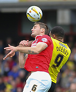 Picture by David Horn/Focus Images Ltd +44 7545 970036<br /> 14/09/2013<br /> Troy Deeney of Watford (right) and Dorian Dervite of Charlton Athletic (left) during the Sky Bet Championship match at Vicarage Road, Watford.