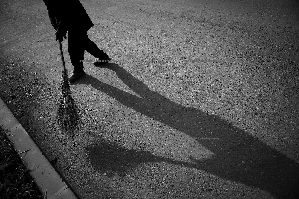 "Street weeper Rusana during her morning job on Ghazanchetsots-Boulevard. This image is part of the photoproject ""The Twentieth Spring"", a portrait of caucasian town Shushi 20 years after its so called ""Liberation"" by armenian fighters. In its more than two centuries old history Shushi was ruled by different powers like armeniens, persians, russian or aseris. In 1991 a fierce battle for Karabakhs independence from Azerbaijan began. During the breakdown of Sowjet Union armenians didn´t want to stay within the Republic of Azerbaijan anymore. 1992 armenians manage to takeover ""ancient armenian Shushi"" and pushed out remained aseris forces which had operate a rocket base there. Since then Shushi became an ""armenian town"" again. Today, 20 yeras after statement of Karabakhs independence Shushi tries to find it´s opportunities for it´s future. The less populated town is still affected by devastation and ruins by it´s violent history. Life is mostly a daily struggle for the inhabitants to get expenses covered, caused by a lack of jobs and almost no perspective for a sustainable economic development. Shushi depends on donations by diaspora armenians. On the other hand those donations have made it possible to rebuild a cultural centre, recover new asphalt roads and other infrastructure. 20 years after Shushis fall into armenian hands Babies get born and people won´t never be under aseris rule again. The bloody early 1990´s civil war has moved into the trenches of the frontline 20 kilometer away from Shushi where it stuck since 1994. The karabakh conflict is still not solved and could turn to an open war every day. Nonetheless life goes on on the south caucasian rocky tip above mountainious region of Karabakh where Shushi enthrones ever since centuries."