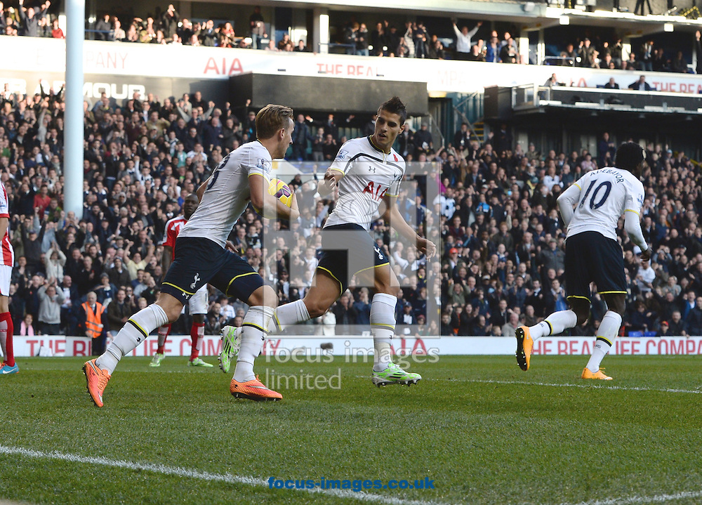 Harry Kane(left) of Tottenham Hotspur runs back to the center  spot with the ball after they score to make it 1-2 during the Barclays Premier League match at White Hart Lane, London<br /> Picture by Alan Stanford/Focus Images Ltd +44 7915 056117<br /> 09/11/2014