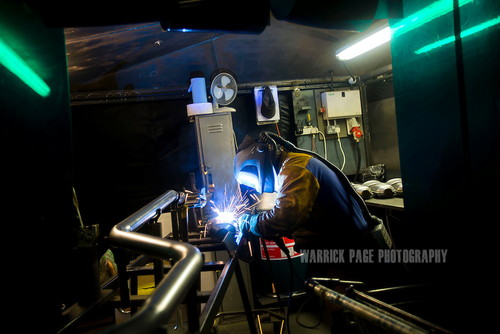 A factory worker welds components at the BM Catalysts factory on February 6, 2013, in Mansfield, England. (Photo by Warrick Page)