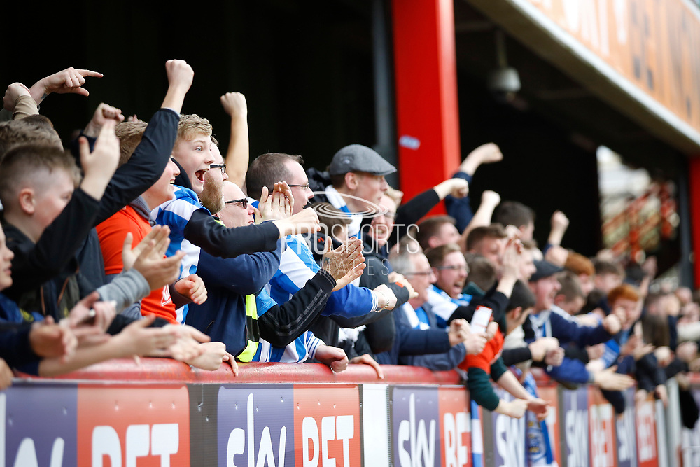 Huddersfield fans celebrates the opening goal (score 0-1) during the EFL Sky Bet Championship match between Brentford and Huddersfield Town at Griffin Park, London, England on 11 March 2017. Photo by Andy Walter.