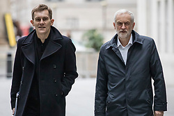 © Licensed to London News Pictures. 13/01/2019. London, UK. Leader of the Labour Party Jeremy Corbyn MP (R) and Labour Party Executive Director of Strategy and Communications Seamus Milne (L) arrive at BBC Broadcasting House to appear on The Andrew Marr Show. Photo credit: Rob Pinney/LNP