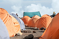 A sea of tents covers the landscape on the slopes of Mount Kilimanjaro in Tanzania. Porters work hard, for very little in the way of compensation, to bring climbers to the summit of the highest peak in Africa.
