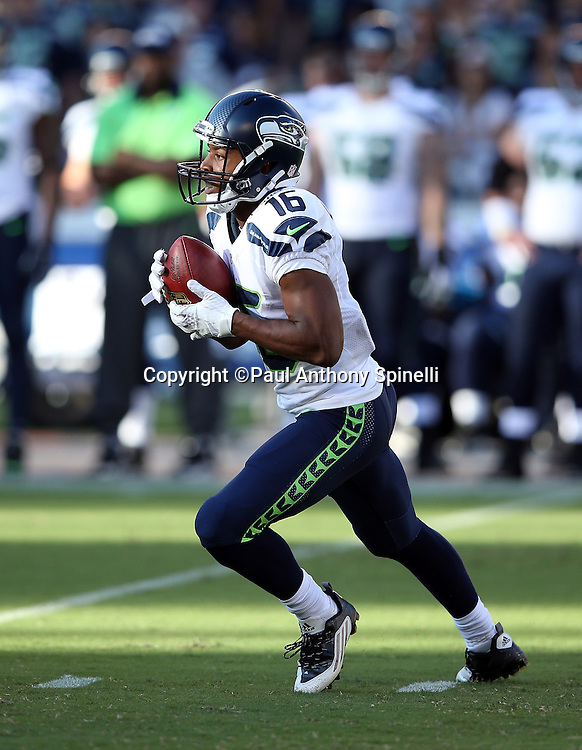 Seattle Seahawks rookie wide receiver, punt returner, and kick returner Tyler Lockett (16) returns a second quarter punt for a 67 yard touchdown and a 7-3 Seahawks lead during the 2015 NFL preseason football game against the San Diego Chargers on Saturday, Aug. 29, 2015 in San Diego. The Seahawks won the game 16-15. (©Paul Anthony Spinelli)