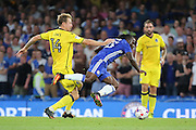 Bristol Rovers midfielder Chris Lines (14) fouling Chelsea attacker Victor Moses (15) during the EFL Cup match between Chelsea and Bristol Rovers at Stamford Bridge, London, England on 23 August 2016. Photo by Matthew Redman.