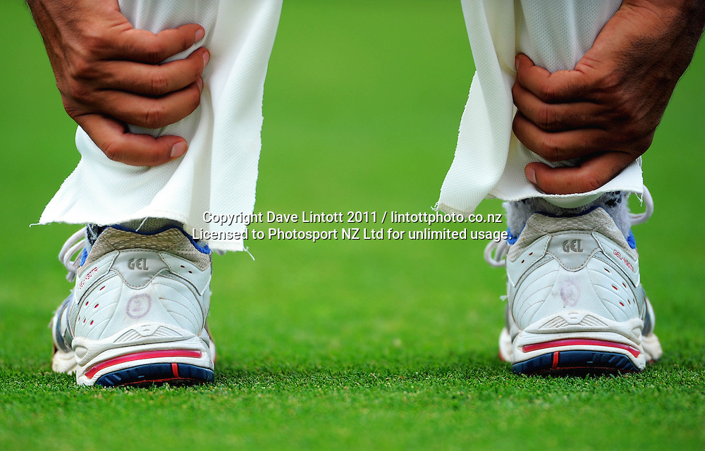 Pakistan's Umar Gul stretches. 2nd cricket test match - New Zealand Black Caps v Pakistan, day four at the Basin Reserve, Wellington, New Zealand on Tuesday, 18 January 2011. Photo: Dave Lintott / photosport.co.nz