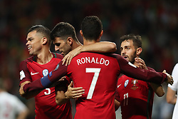 August 31, 2017 - Porto, Porto, Portugal - Portugal's forward Nelson Oliveira (C) celebrates after scoring a goal with Portugal's forward Cristiano Ronaldo (R) and Portugal's defender Pepe (L) during the FIFA World Cup Russia 2018 qualifier match between Portugal and Faroe Islands at Bessa Sec XXI Stadium on August 31, 2017 in Porto, Portugal. (Credit Image: © Dpi/NurPhoto via ZUMA Press)