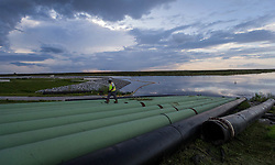 September 13, 2017 - Belle Glade, Florida, U.S. - A worker checks bypass pipes at the Herbert Hoover Dike culvert 12A replacement project. Debris from Hurricane Irma was cleaned out of the bypass pipes so that canal water can be  pumped into Lake Okeechobee near Belle Glade, Florida on September 13, 2017. (Credit Image: © Allen Eyestone/The Palm Beach Post via ZUMA Wire)