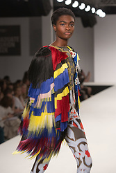© Licensed to London News Pictures. 31/05/2014. London, England. Collection by Krasimira Ivanova-Stroyneva from UEL, University of East London. Graduate Fashion Week 2014, Runway Show at the Old Truman Brewery in London, United Kingdom. Photo credit: Bettina Strenske/LNP
