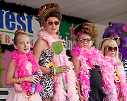 Miss Honette contestants stand on stage at Honfest 2014 in Baltimore, MD on Saturday, June 14, 2014.