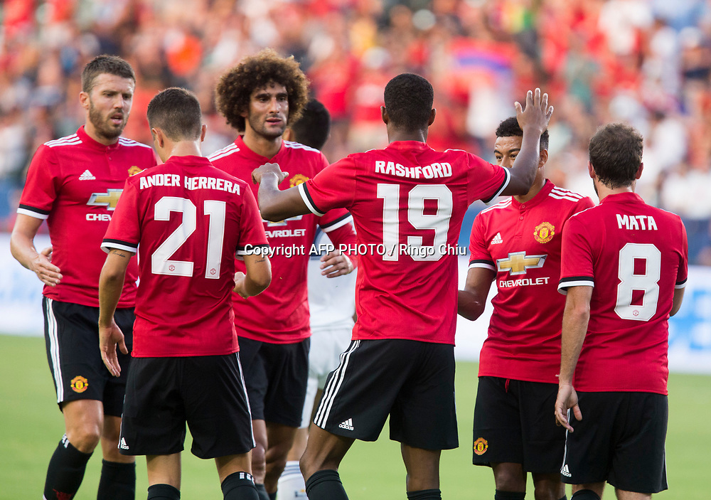 Manchester United Marcus Rashford, 3rd left, celebrates his goal with teammates during the first half of a national friendly soccer game at StubHub Center on July 15, 2017 in Carson, California.   AFP PHOTO / Ringo Chiu