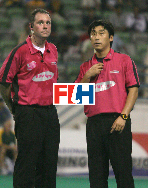 Kuala Lumpur:   Kim Hong Lee, Korean Umpire (right)and Van Eert Roel of Netherlands waiting for the Television Umpire to solve a dispute in the match between Australia and Pakistan in the Samsung Hockey Men Champions Trophy at the National Stadium, Bukit Jalil, Kuala Lumpur, Malaysia on 02 Dec 2007. <br /> Australia beat Pakistan 2-1.<br /> Photo:GNN/Vino John