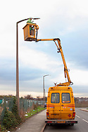 Council electrician maintaining street lighting .