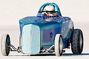The best cars-people-atmosphere-photos of 2009 Bonneville Speed Week- Wasted Willie's Flatheads Roadster, driven by owner, Willie Glass of Sandston, VA. pulls off the long track after making a run, August 9, 2009.  Photos by Colin E. Braley